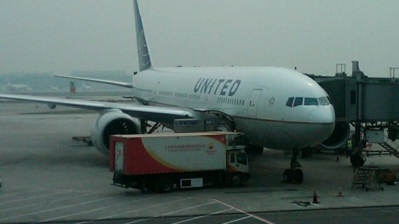 The United Airlines plane waiting at Beijing's airport which will take Chen Guangcheng to America