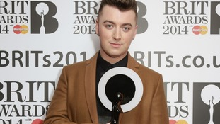 Sam Smith holds his Critics' Choice Brit Award heading to today's nominations launch event.