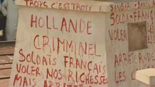 Graffiti accuses the French of coming to steal CAR's riches.