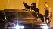 French humorist Dieudonne M'bala M'bala waves to fans at the Zenith concert hall in Nantes.