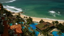 Villas by a white sand beach facing the Indian ocean at a luxurious resort in Nusa Dua, Bali