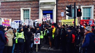 Protesters outside Tottenham Police station stopped to hold a minute silence for Mark Duggan.