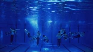 Tom swam with some mermaids on Splash.