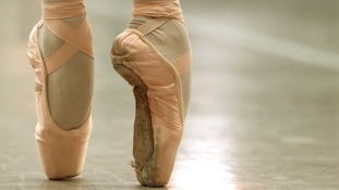 File photo of a ballerina in pink ballet shoes.