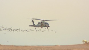 The undamaged Pave Hawk leaves the shingle bank