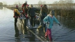Children get a ride in a boat to get them to school.