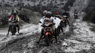 Villagers evacuate Sigarang-Garang village after ash from Mount Sinabung rained down onto their homes