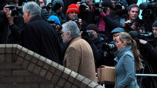 The press jostle for a shot of Dave Lee Travis arriving at court