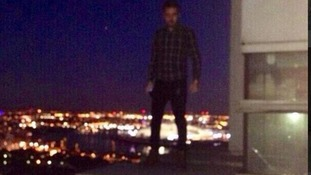 This picture of Liam Payne on the balcony ledge was published on his friend's Twitter feed