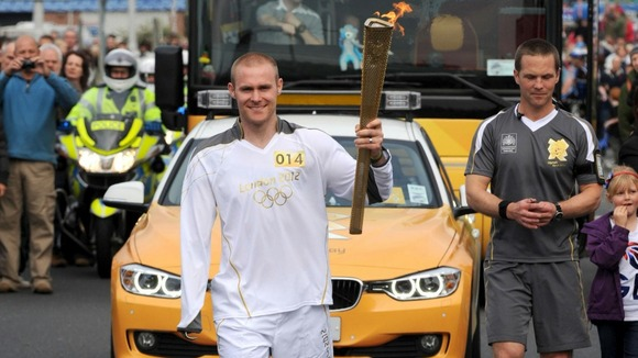 Torchbearer 014 Mark Ormrod carrying the Olympic flame on the leg between Plymouth and Modbury