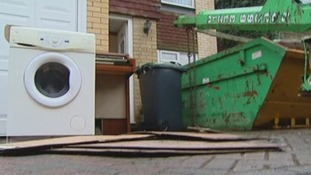 A skip is placed outside a home in Tonbridge, Kent, following the floods.