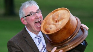 World Scotch Pie Champion Stephen McAllister poses with his prize