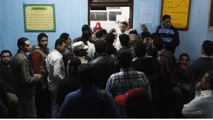 eople arrive outside a polling centre to vote in a referendum on Egypt's new constitution in Cairo.