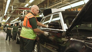man on car production line