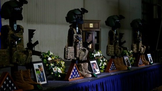 Weapons and equipment belonging to the US aircrew who died are displayed in a hangar before a memorial service