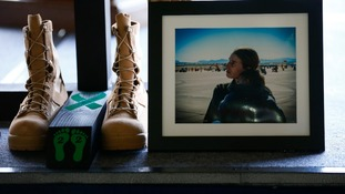 A photograph of, and boots belonging to, Staff Sgt Afton Ponce