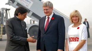 Shashi Tharoor (L) with Canadian Prime Minister Stephen Harper as Harper's wife Laureen