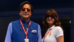 Sunanda Puskhar poses with her husband Shashi Tharoor at the Indian F1 Grand Prix in New Delhi