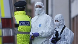 Police forensic officers near the family home of Mikaeel Kular in Edinburgh