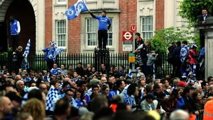 Chelsea fans gather outside Stamford Bridge before the FA Cup and UEFA Champions League trophy parade in London.