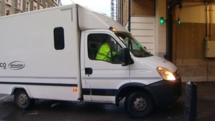 A police van arrives at Westminster Magistrates Court in London this morning.
