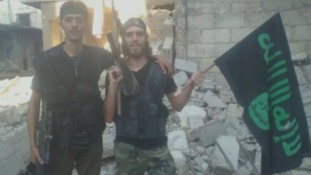 One of Khateeb's photos appearing to show rebel fighters posing with an Islamist flag