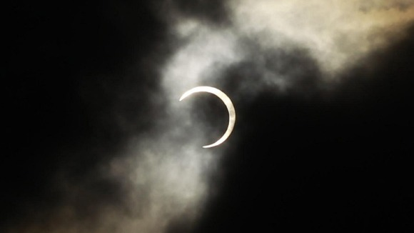 An annular solar eclipse is seen briefly during a break in clouds over Taipei, Taiwan