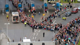 Torchbearer Andrew Ball from Saltash, runs over the Tamar Bridge to Plymouth, during the torch relay yesterday.