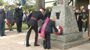 Private Ford's mother, Jane, lays a wreath at the memorial