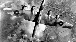 An RAF Halifax bomber pictured during an attack on an oil plant in Germany's Ruhr