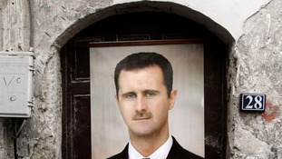 A portrait of Syrian President Bashar al-Assad hangs over a doorway in Damascus