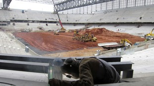 A welder at work in the Arena da Baixada stadium in Curitiba