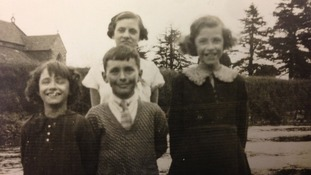 Four children shown smiling in one of the pictures found