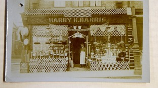 A photograph of a shop belonging to Harry Harris, who hoped to avoid war service on economic grounds to look after his business