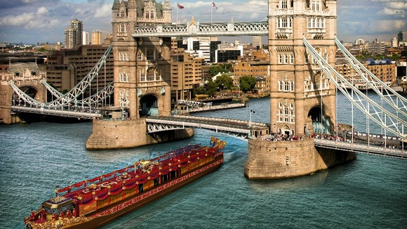 An artist&#x27;s impression of the royal barge passing by Tower Bridge.