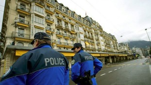 Swiss police on guard outside the site of the conference in Montreux, Switzerland