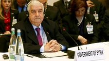 Syria's Foreign Minister Walid al-Moualem at the start of the peace talks
