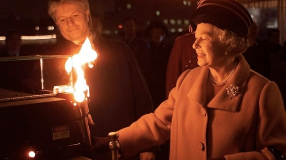 The Queen lighting the Golden Jubilee Beacon in London in 2002