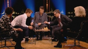 Bill Gates prepares to make his move against Norwegian world chess champion Magnus Carlsen.