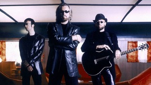 Robin, Barry and Maurice Gibb pose together in this undated publicity photograph