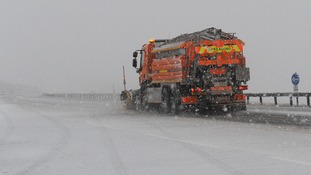 A snow plough clears the A66