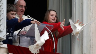 Two doves were released by the Pope and two children