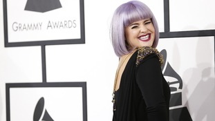 Television personality Kelly Osbourne arrives at the 56th annual Grammy Awards.