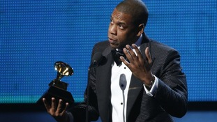 "Jay-Z accepts the award for Best Rap Song for ""Holy Grail"" at the 56th annual Grammy Awards."