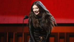 Lorde with her award.