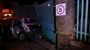 One of the cars also smashed into a wall and some gates