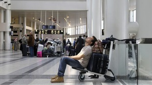A man sleeps on his baggage