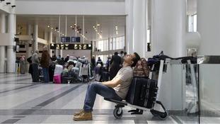 A man sleeps on his baggage