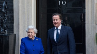 Queen Elizabeth ll is greeted by Prime Minister David Cameron