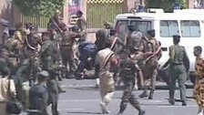 Members of Yemen's armed forces attend to the wounded